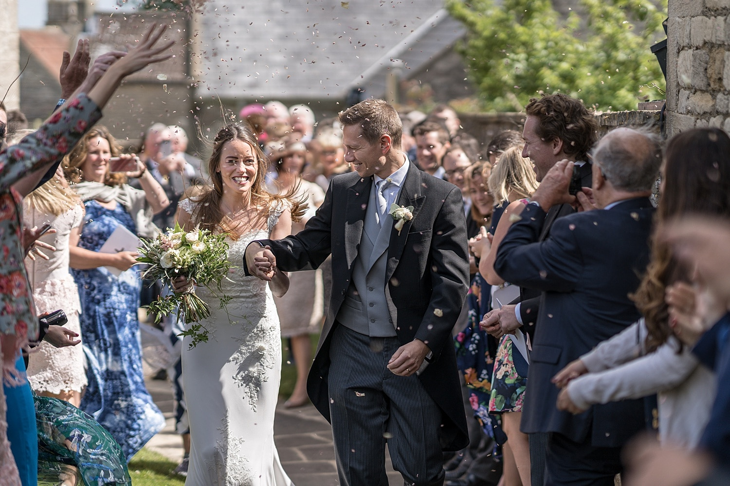 Bride and groom hit with confetti