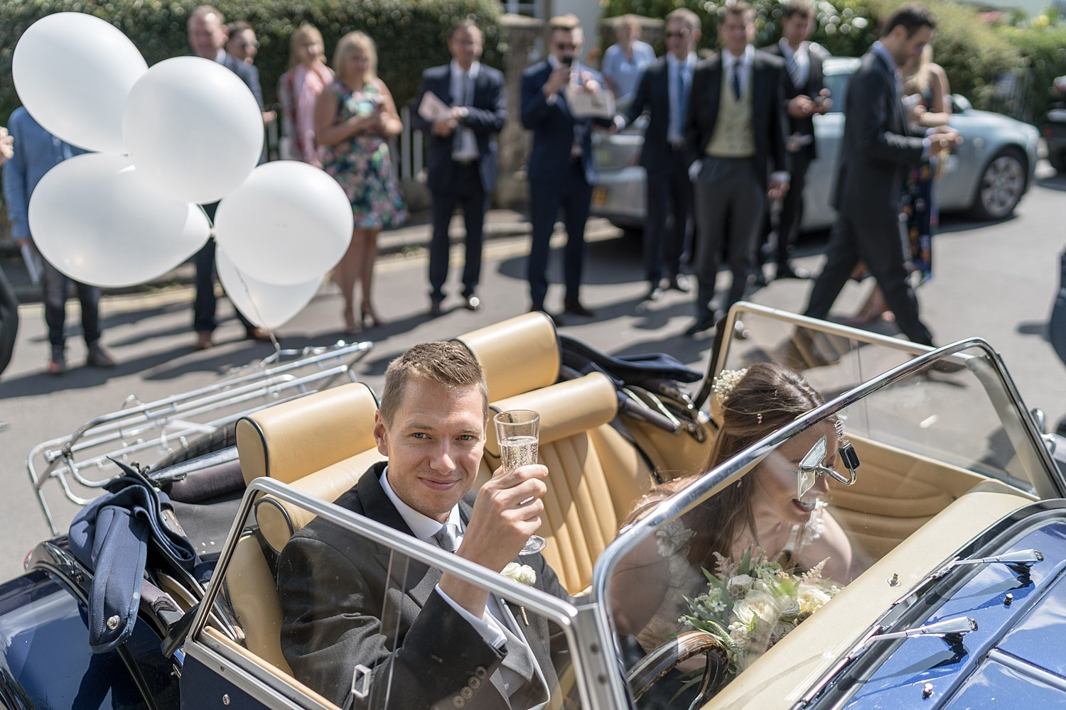 Bride and groom in sports car