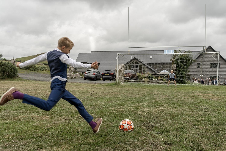 Boy with football at a wedding reception at Tynrhyd Retreat