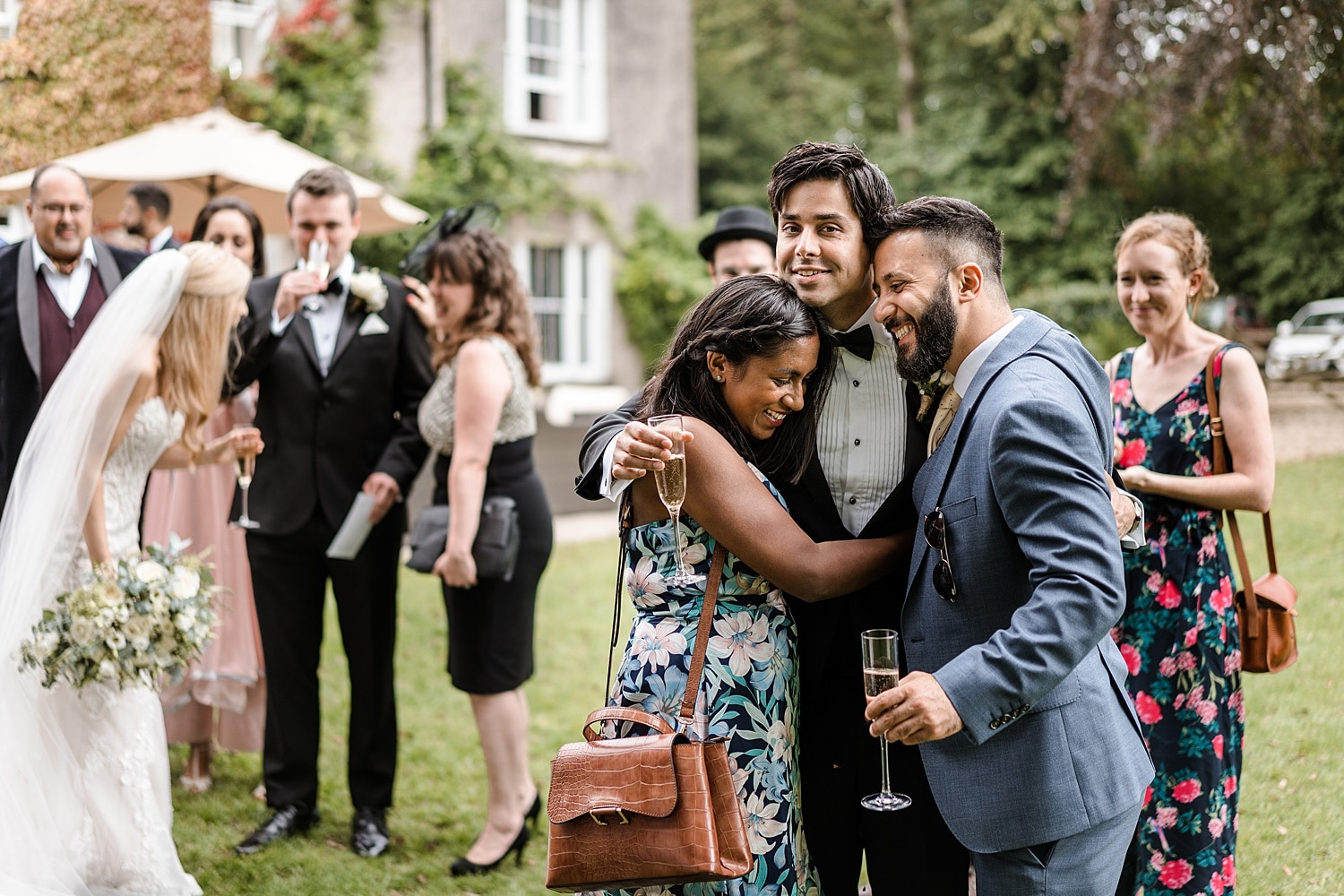 Groom hugging guests