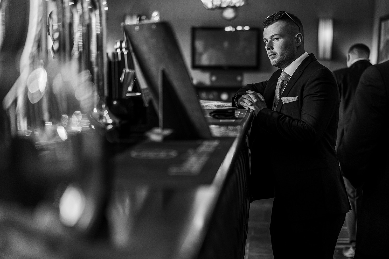 Groom waiting at the bar
