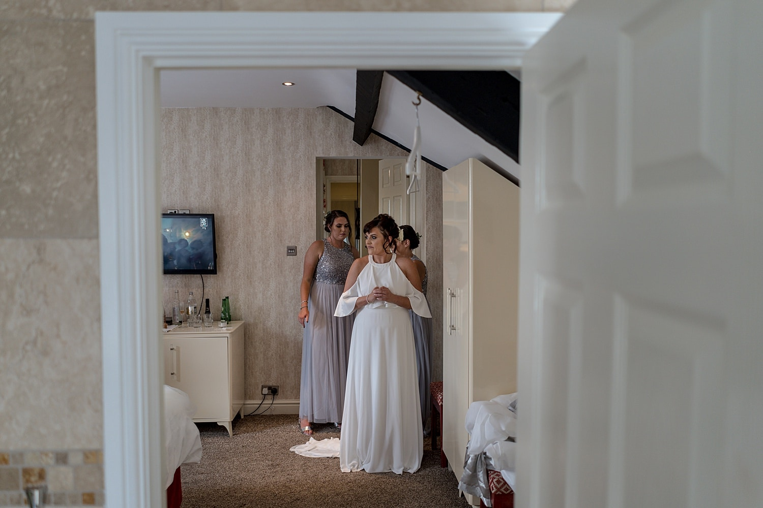 Bride's maids putting dress on