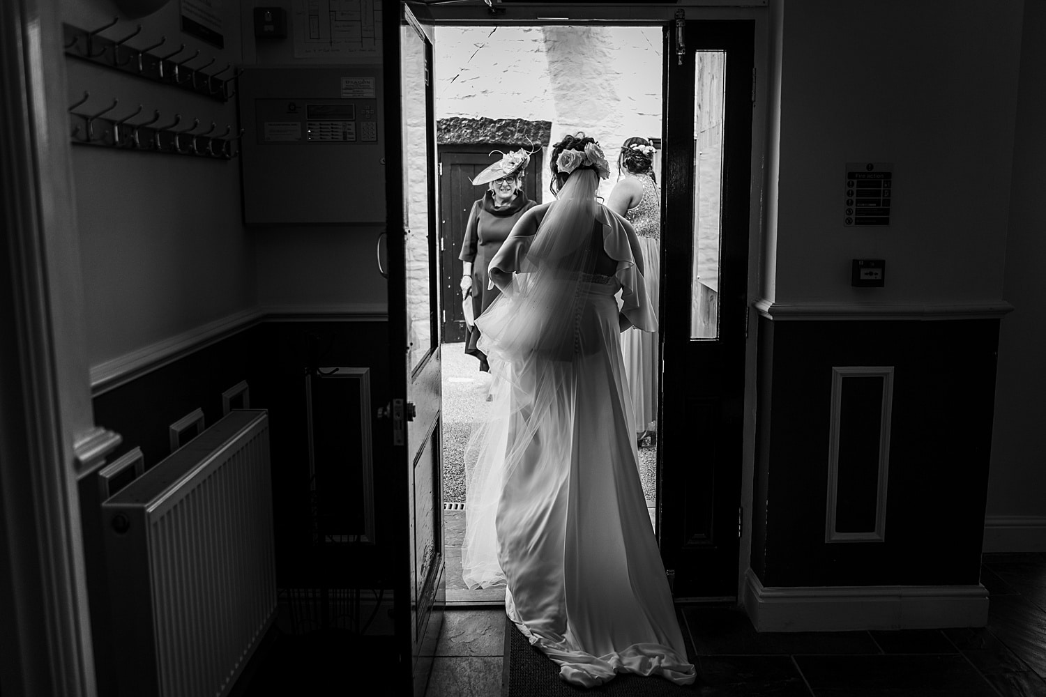 Bride leaving through door