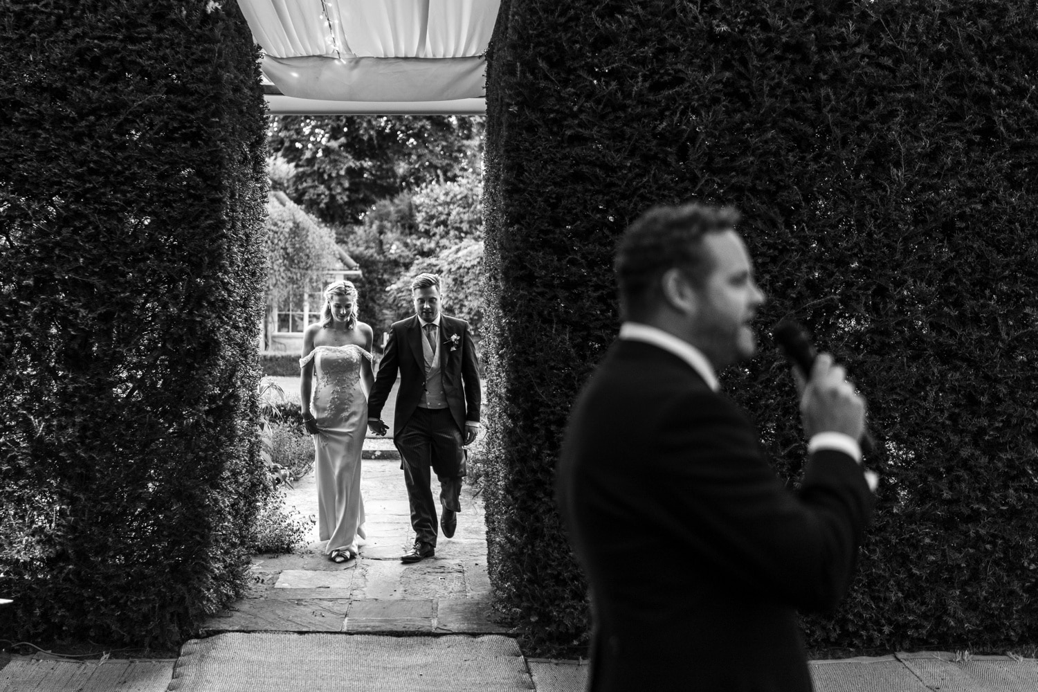 Cotswold wedding photography, bride and groom arriving at wedding breakfast