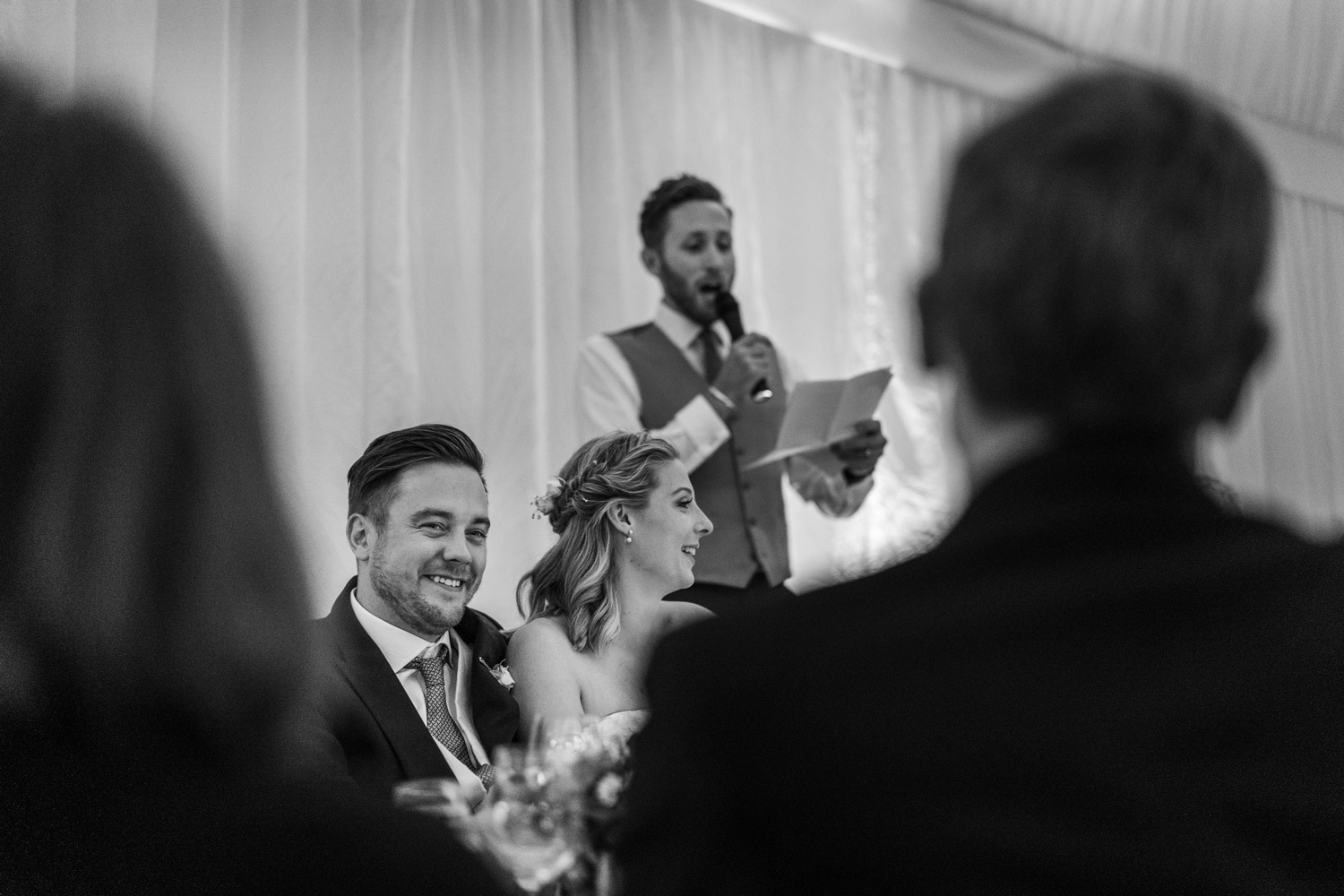 wedding speeches, groom laughing