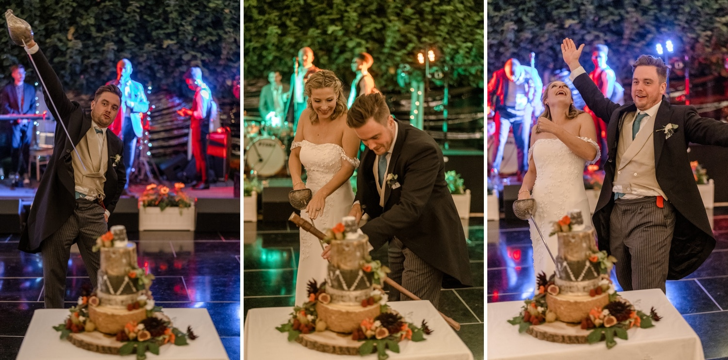 Wedding cake being cut with sword