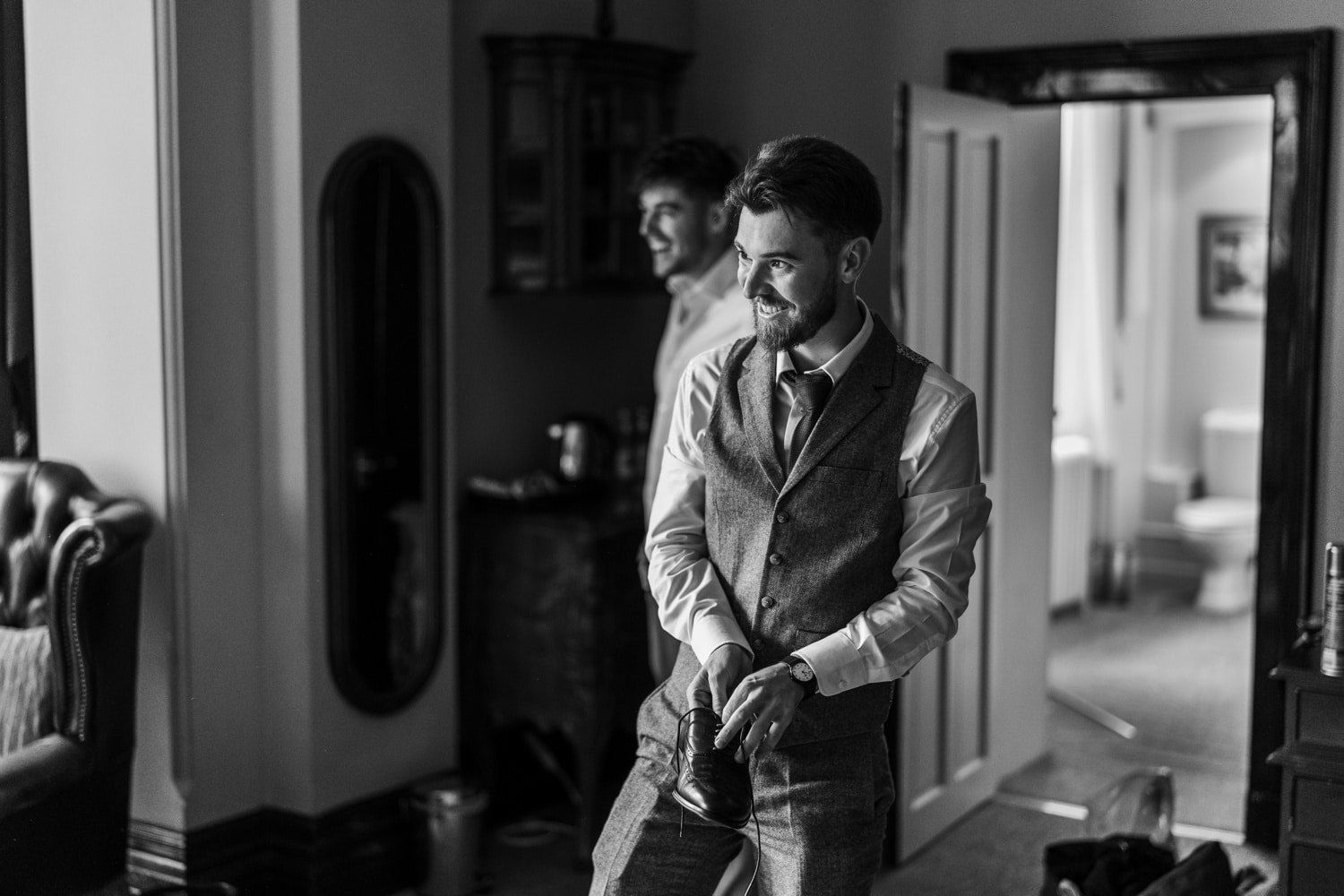 Groom preparations at Orchardleigh House, Somerset