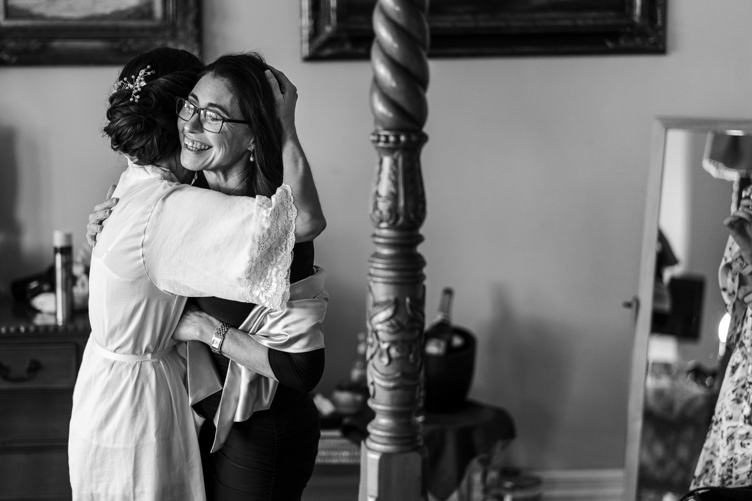 Bride hugging mother
