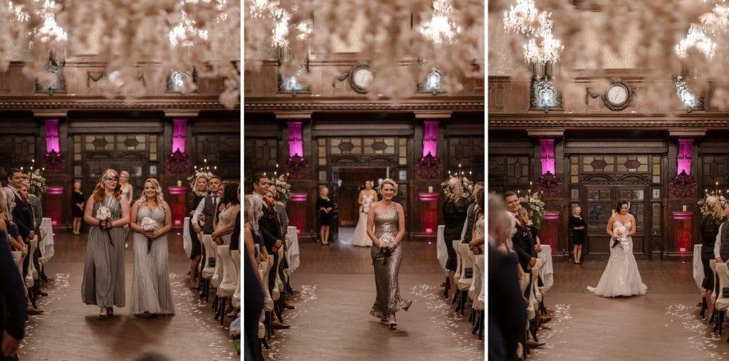 Bridesmaids and bride walking up aisle