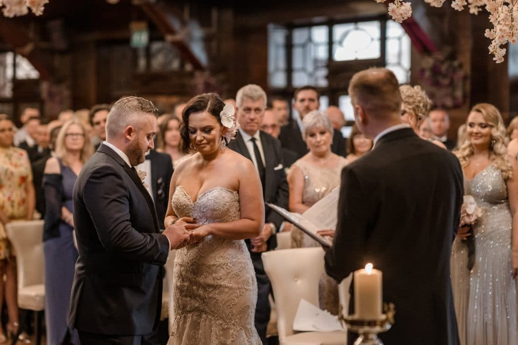 Groom puts on bride's ring