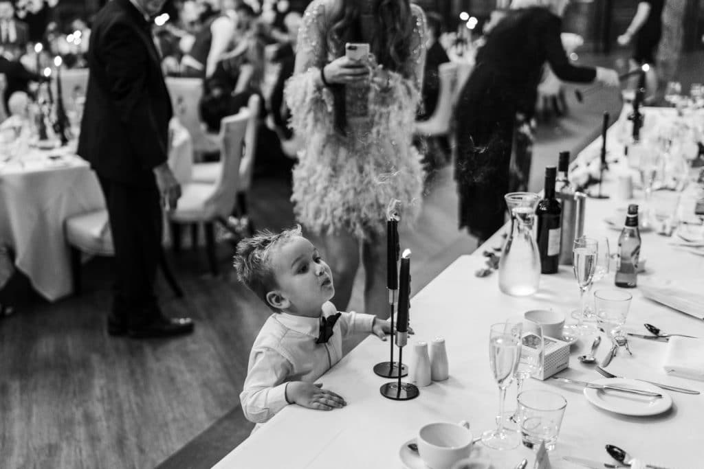 Boy blowing out candle