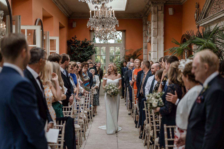 Bride walking up the aisle Orangery at Euridge Manor