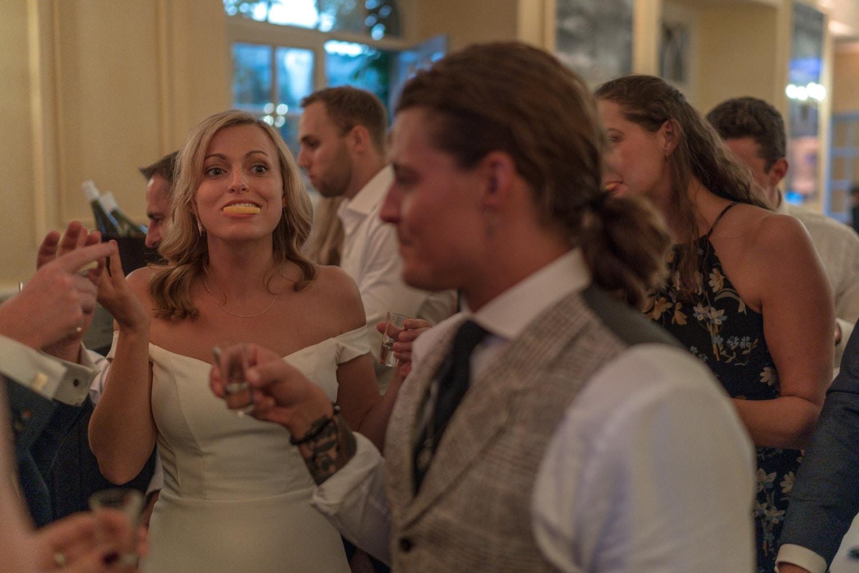 drinking shots at wedding reception