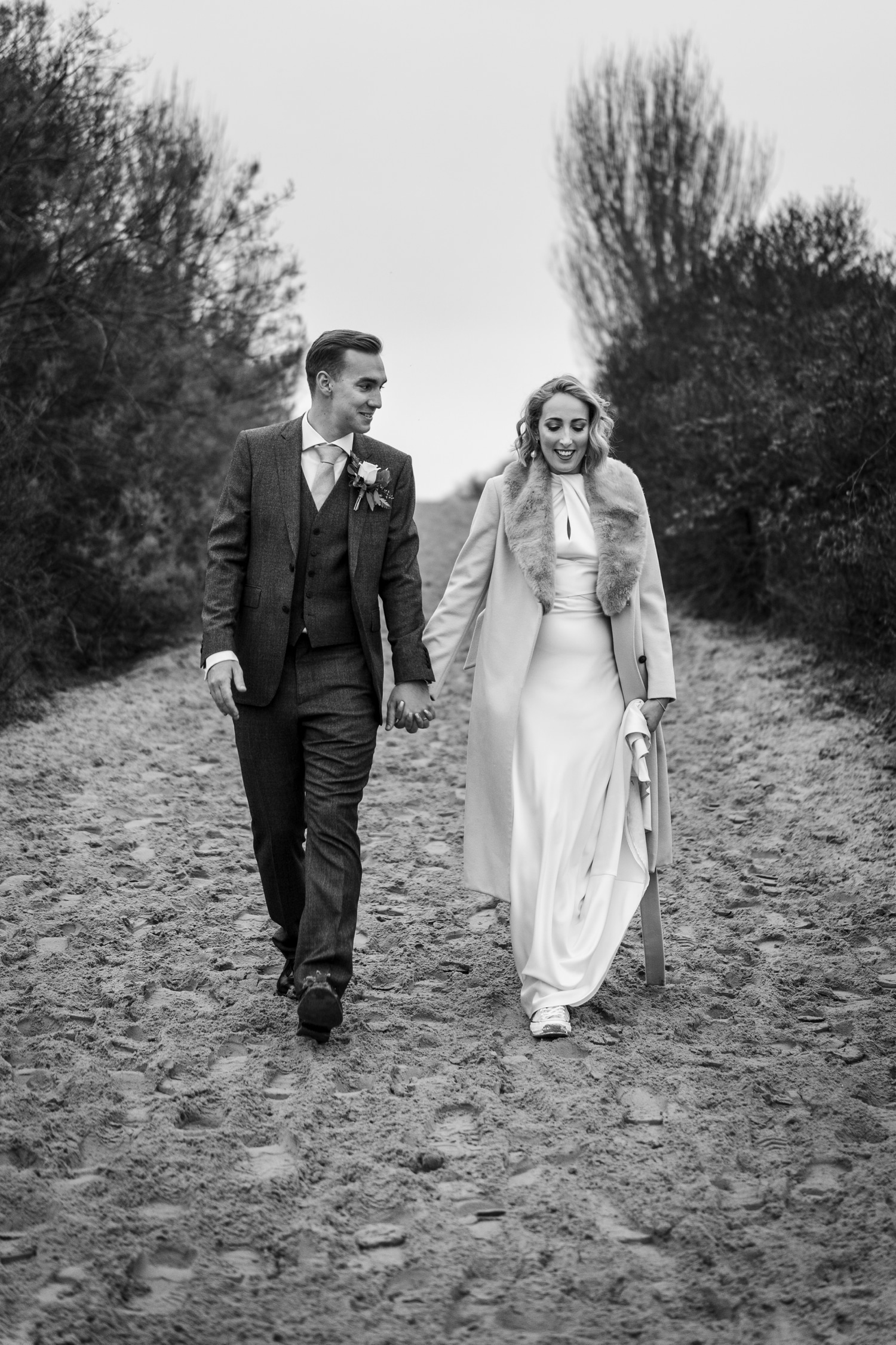 Bride and groom wedding photographs on Camber Sands at The Gallivant
