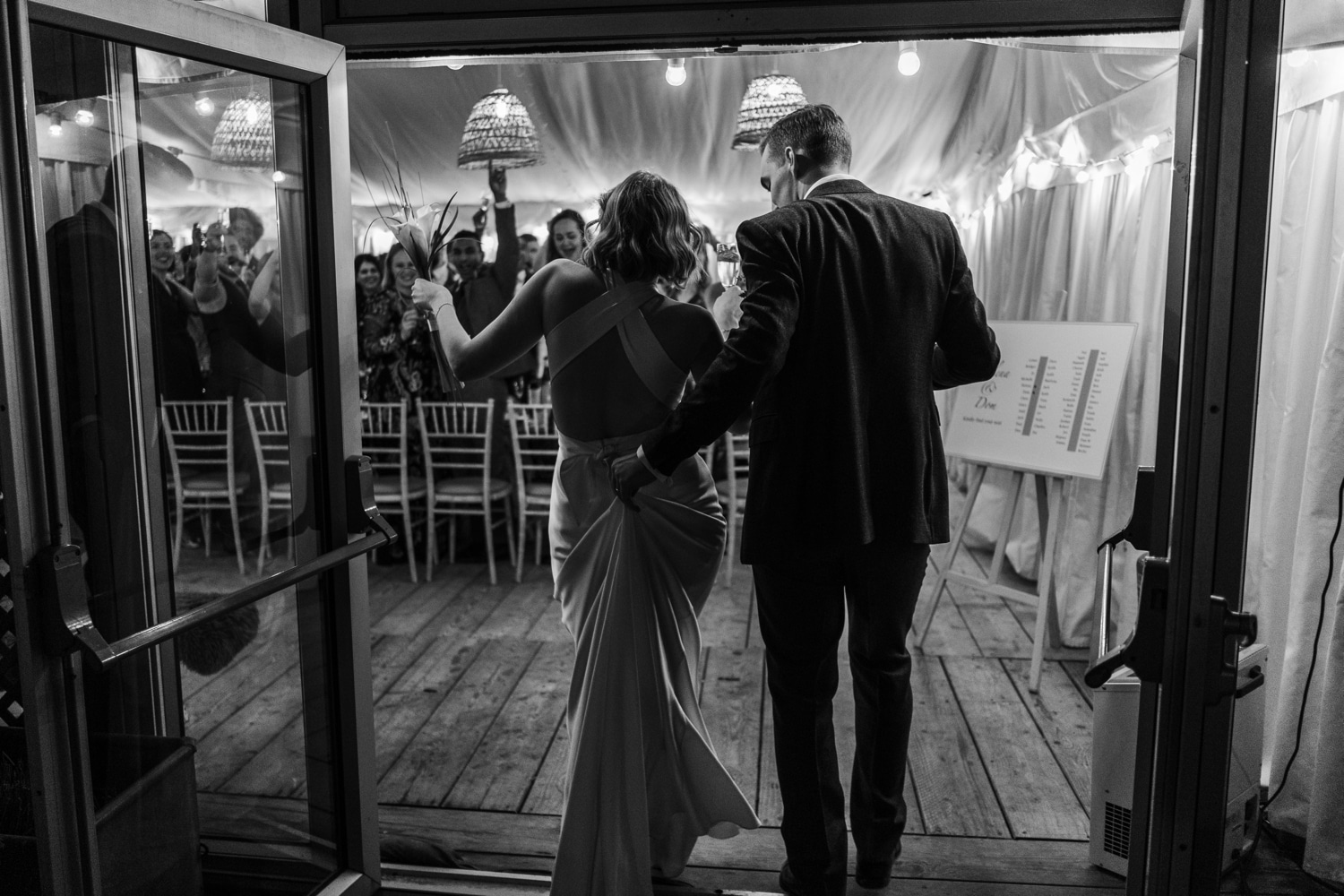 Bride and groom enter the marquee at The Gallivant