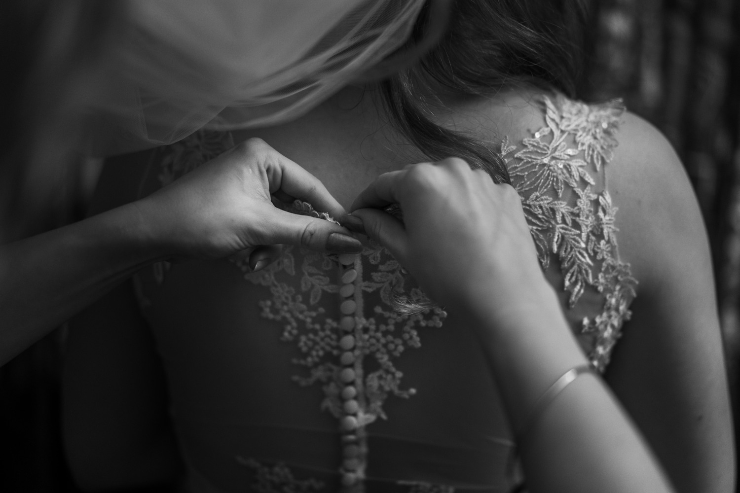 Bridal dress being buttoned