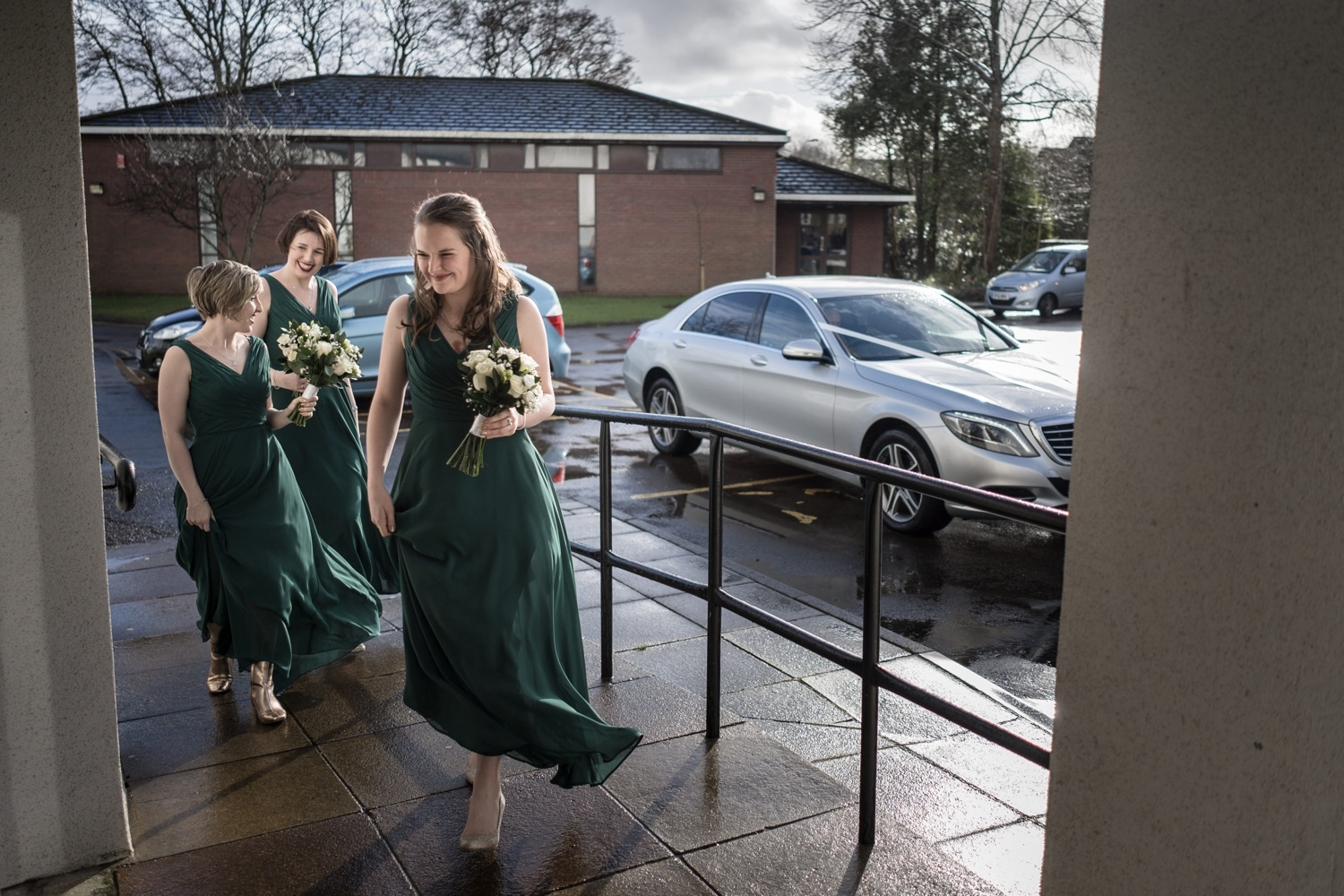 Bridesmaids arrive at St Brigid's Church, Cardiff