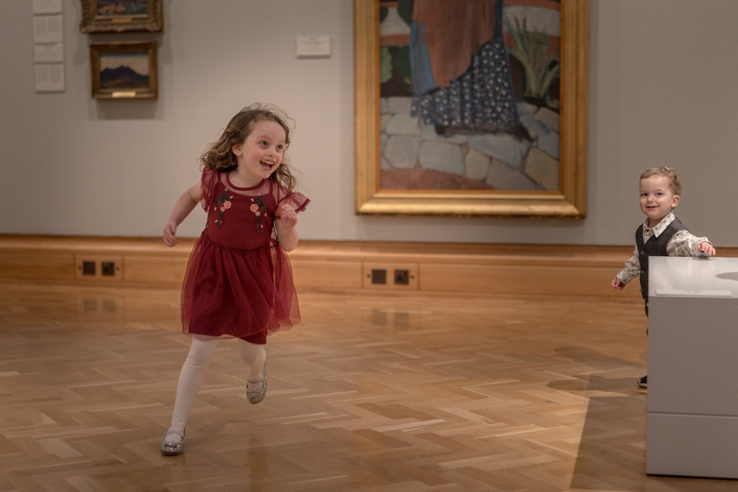 Little girls runs around Cardiff museum wedding reception