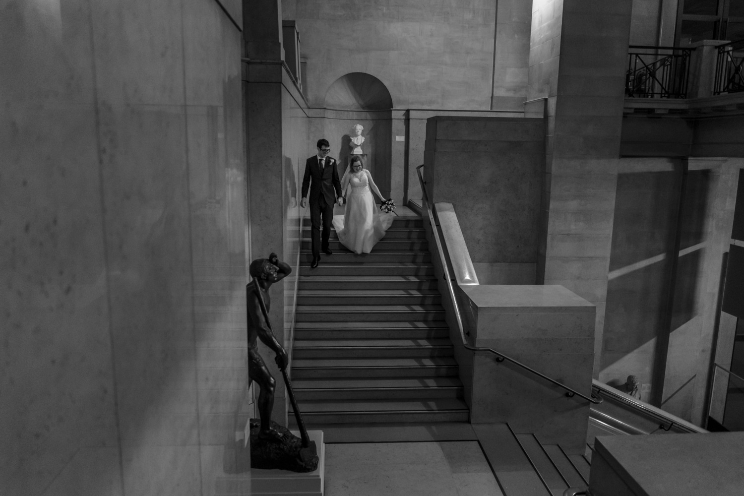 Bride and groom on stairs at Cardiff Museum wedding