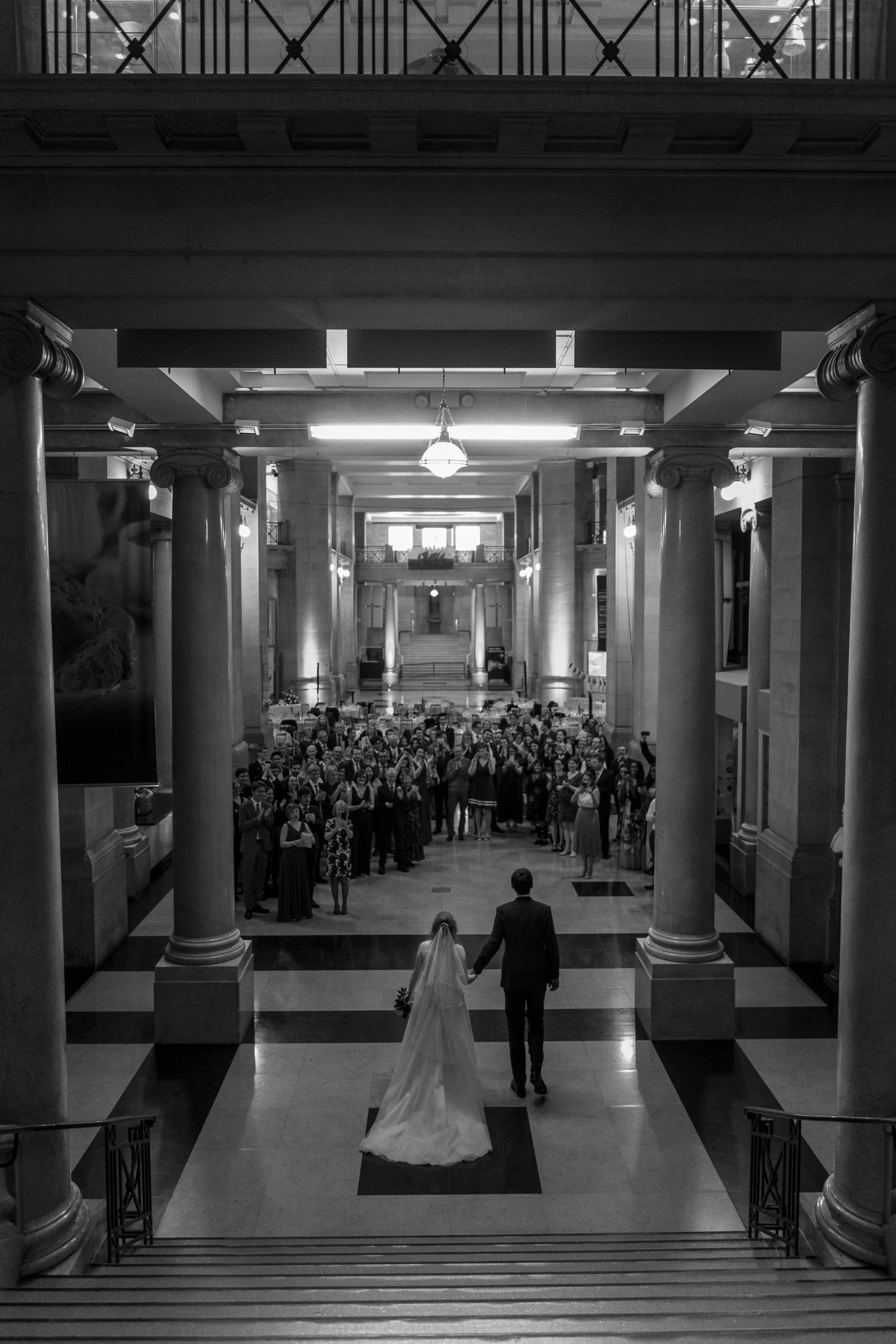 Bride and groom walk to wedding breakfast at Cardiff Museum