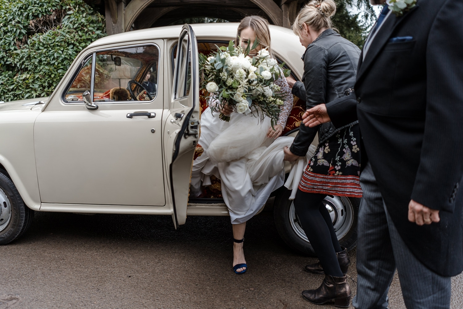 Bride getting out of car at St Tewdrics Church in South Wales