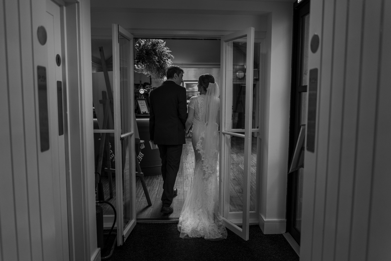 Bride and groom walking through ceremony room
