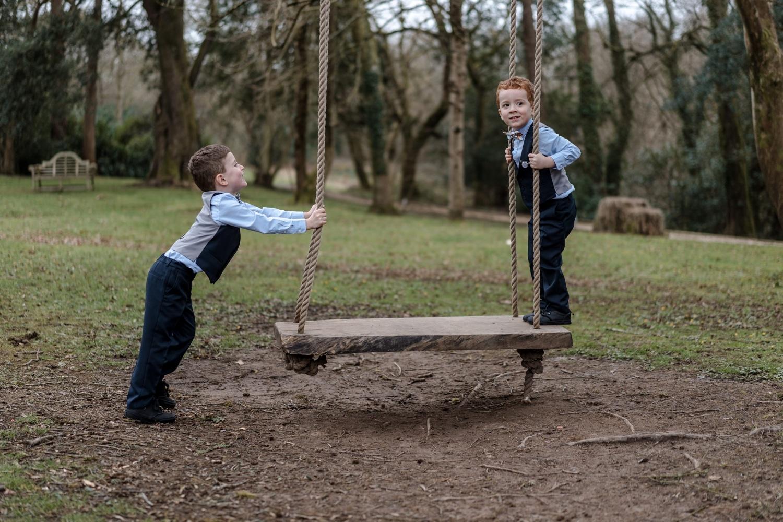 boys play on swing
