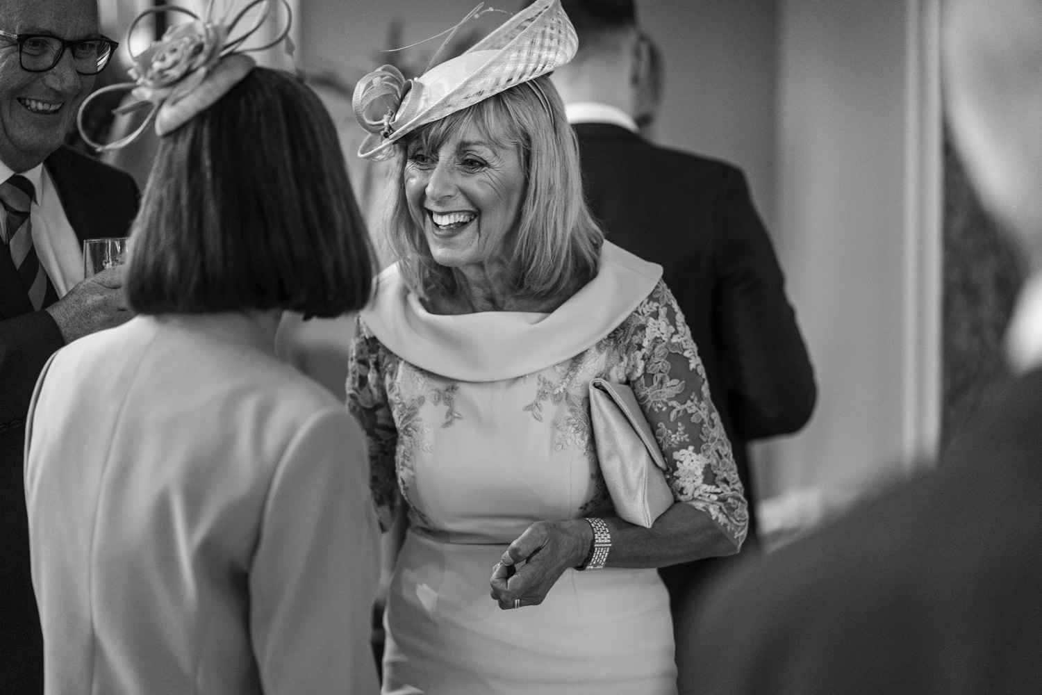 Natural photographs of guests at wedding reception in Fairyhill, South Wales