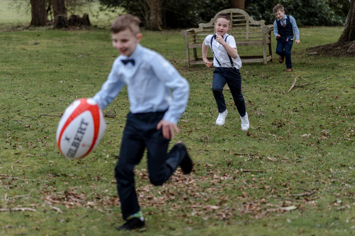 Boys playing rugby at wedding reception