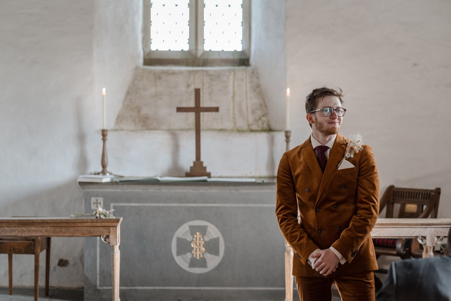 Groom at alter in Mwnt Church