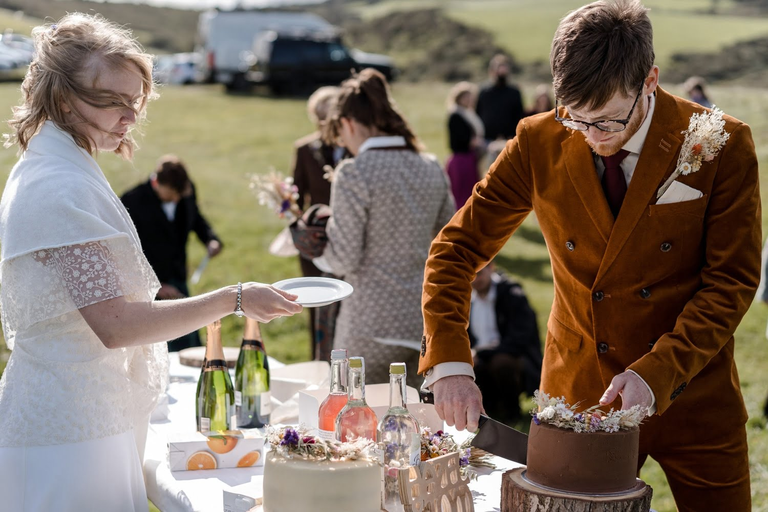 Cake being served at Mwnt following wedding ceremony during covid restrcitions