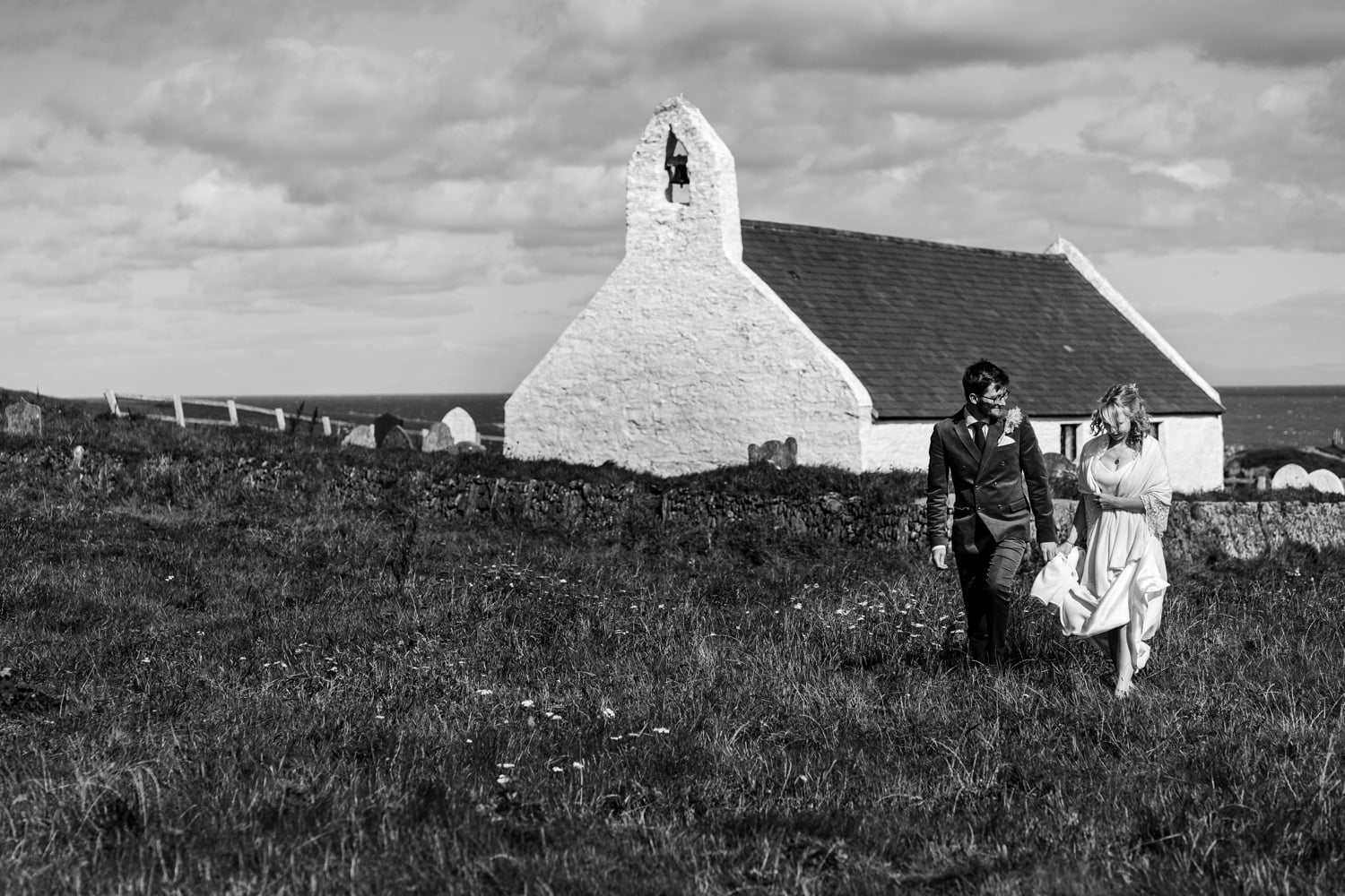 Bride and groom outside of Mwnt Church on their wedding day