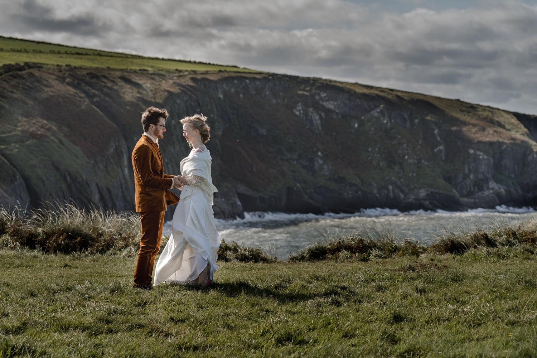 Bride groom overlooking Mwnt Beach