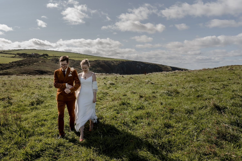 Bride groom overlooking Mwnt Beach in West Wales