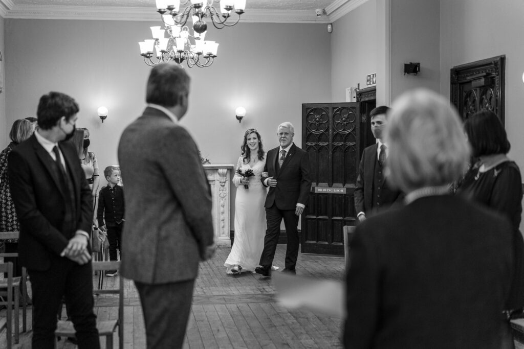 Bride and father walk down aisle at Insole Court