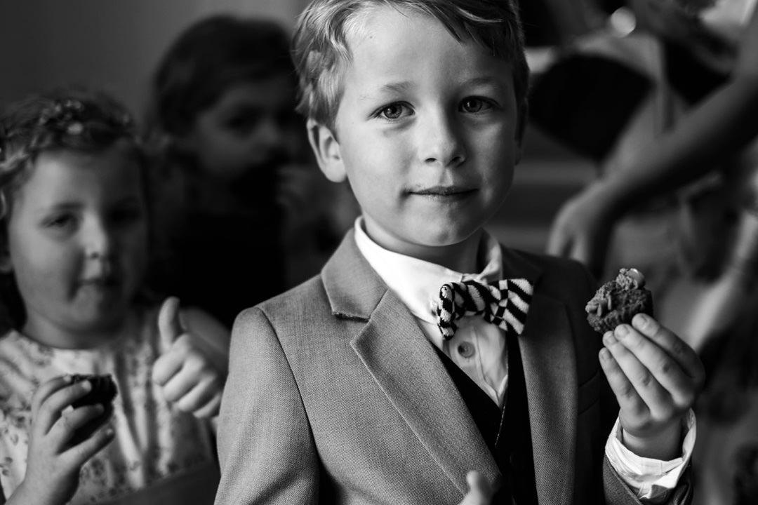 Boy with wedding reception canapé