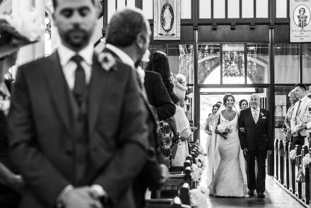 Bride walking up church asile