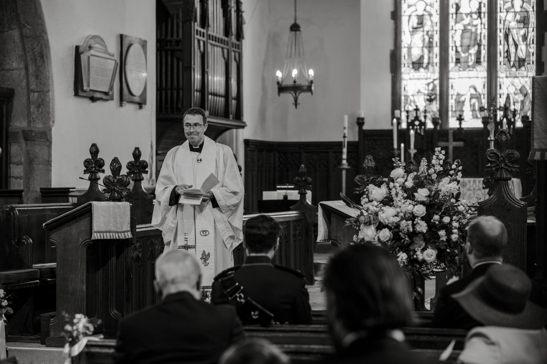 Vicar addressing restricted guests