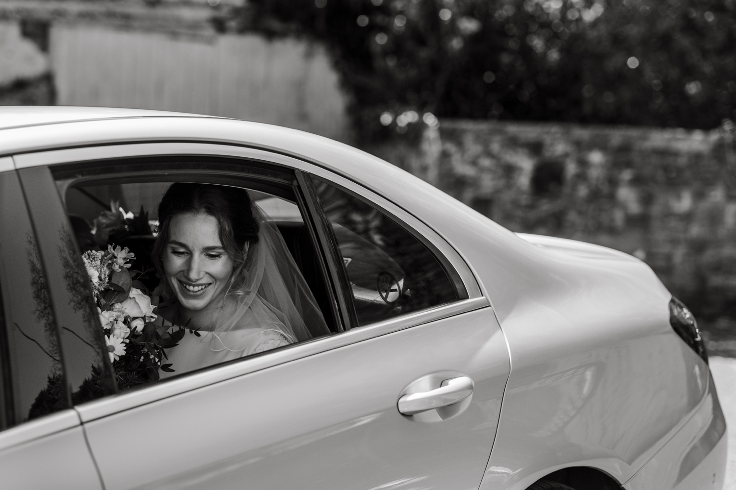 Bride arrives in car for micro wedding