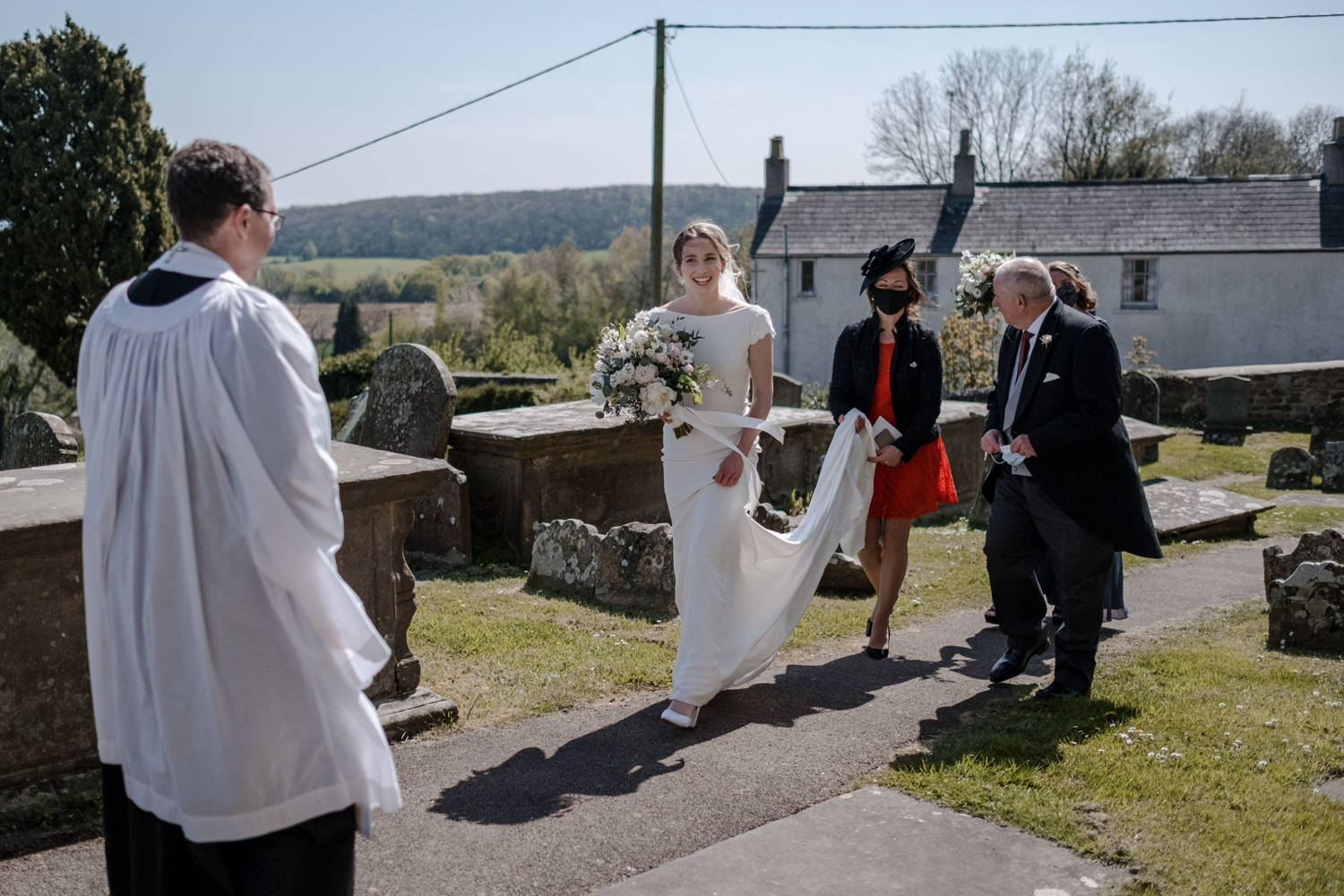 Bride arrives at church for micro wedding