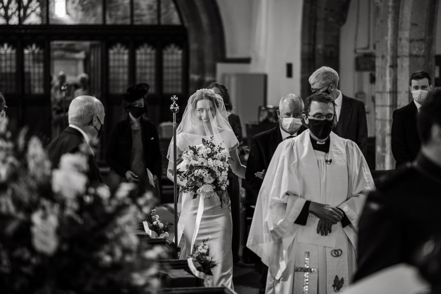Bride and father walks up church aisle at micro wedding