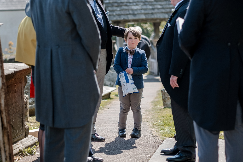 Boy eats crips at wedding