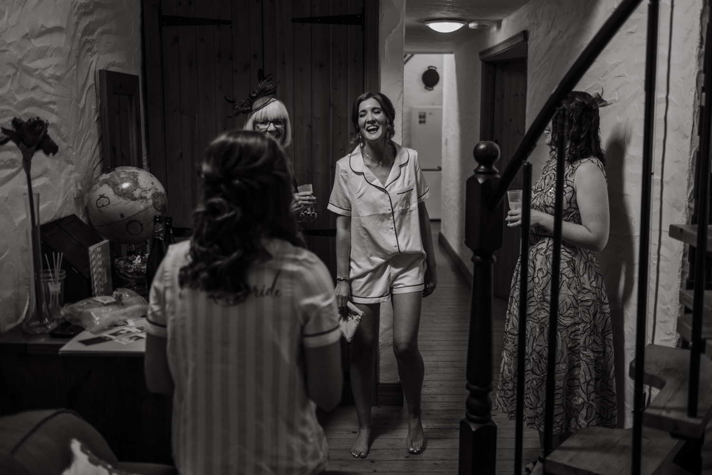 Bride laughing in pyjamas