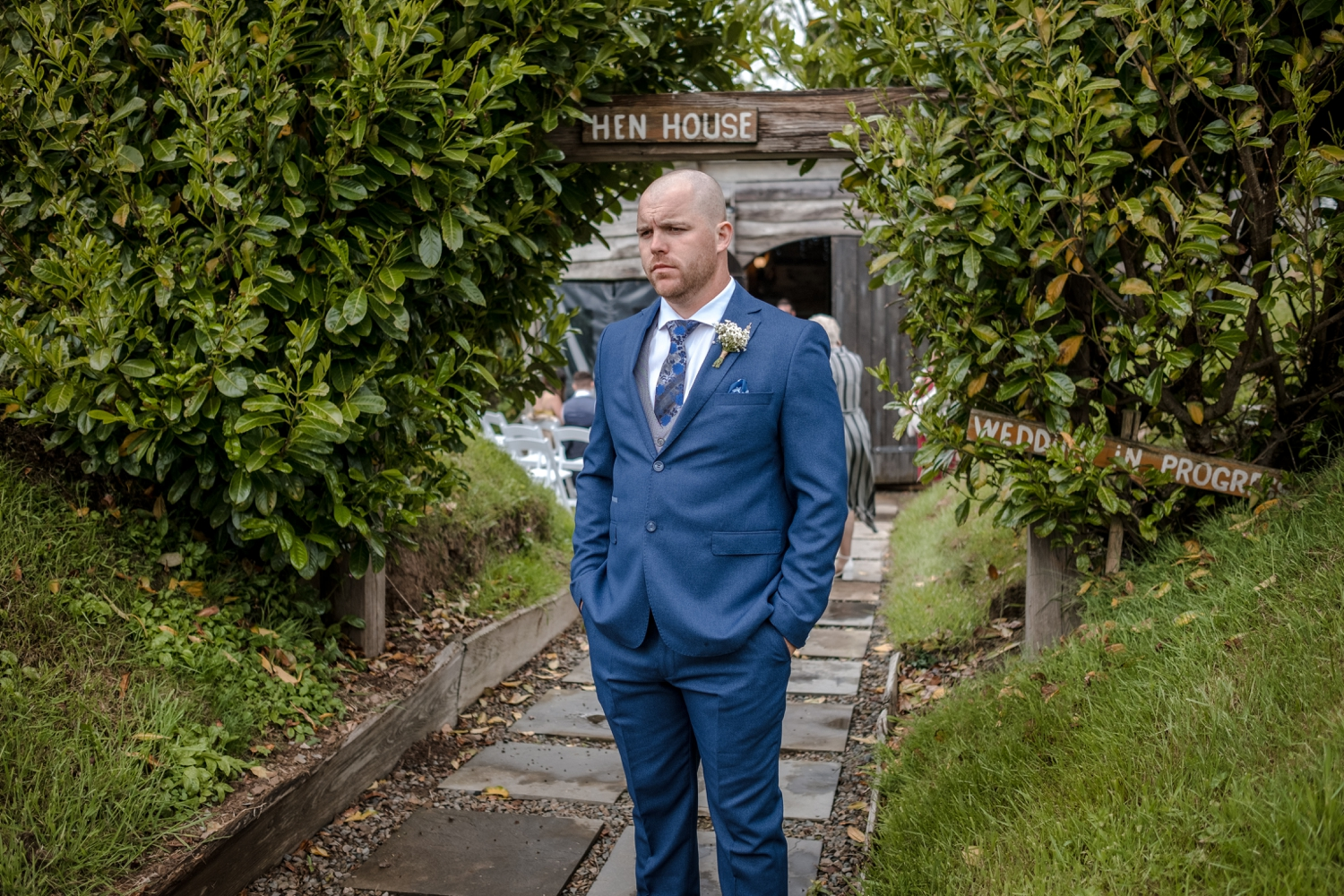Groom waiting outside the hen house at Woodhouse Barn