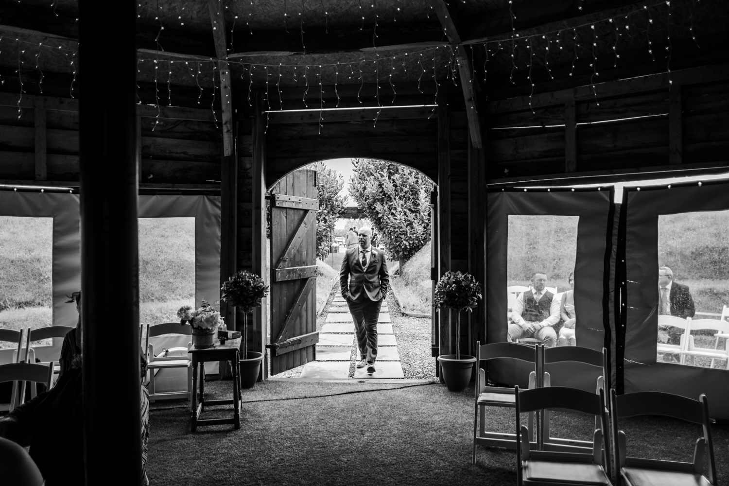 Groom entering the hen house at Woodhouse Barn