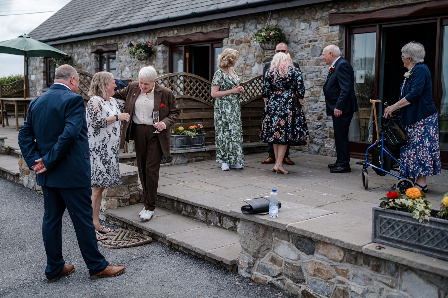 Guest gather for same sex South Wales wedding