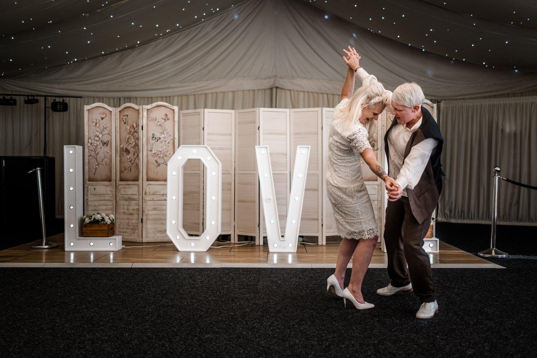 Same sex couple first dance at wedding