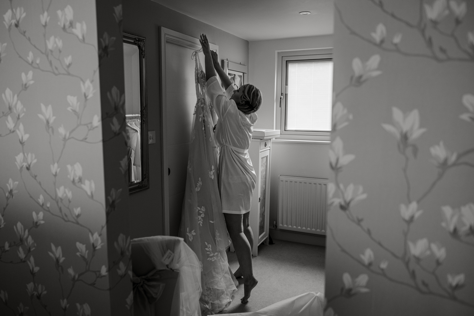 bride reaching for dress for wedding at Llandaff Cathedral