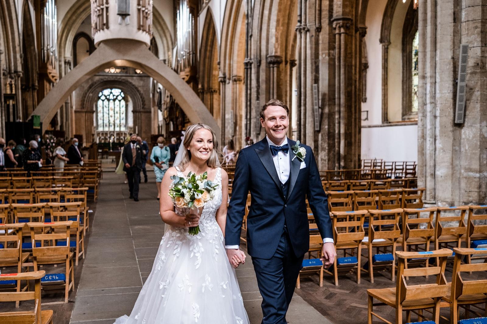 Bride and groom walking down the aisle at Llandaff Cathedral