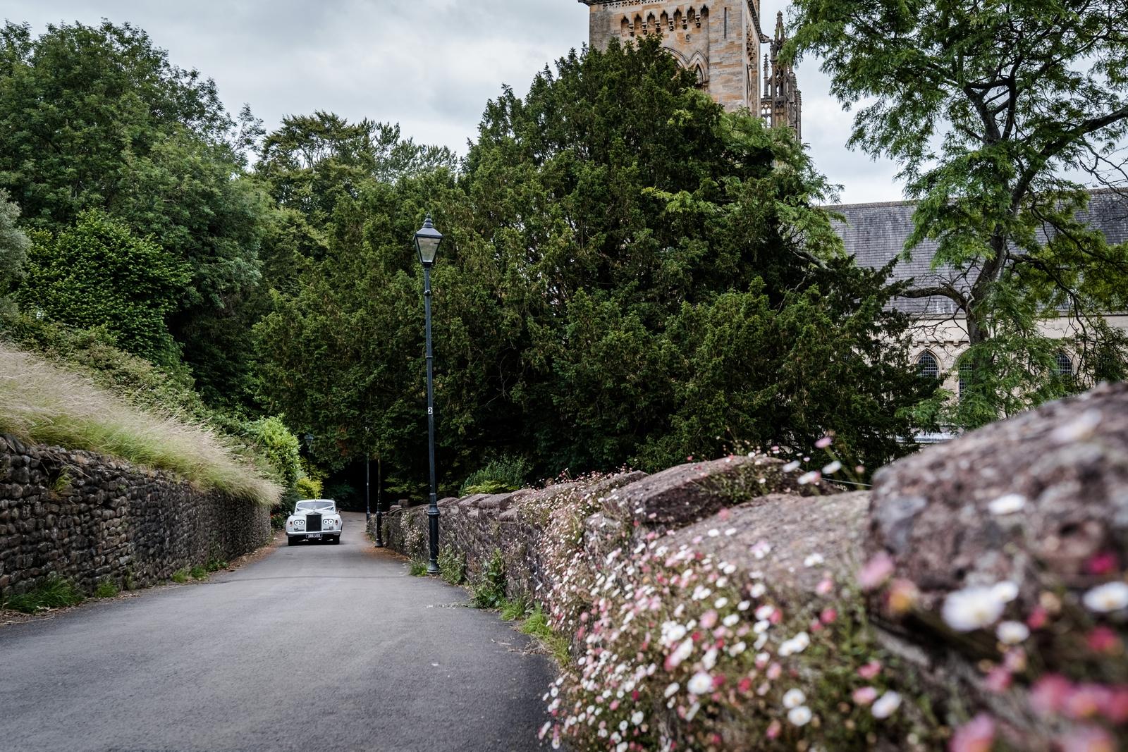 Wedding car driving from Llandaff Cathedral